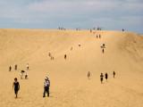 Domestic visitors walking across the dunes