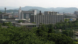 Drab administrative buildings on the horizon