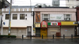 Shops in Moji-kō on a rainy, early morning