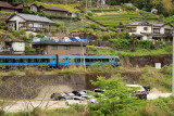Train passing by a village off Tosa-Iwahara