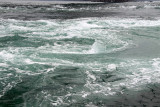 Dissipating whirlpool off the side of the boat