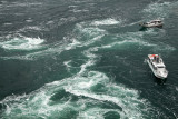 Trio of whirlpools with sightseeing boats