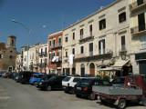Parking along the sun-baked facades