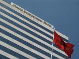 Albanian flag and Tirana International Hotel
