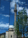 Charshi Mosque reflected in the Parliament building