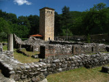 Ruins of older monastery structures and tower