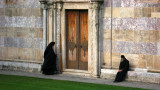 Monks outside the church