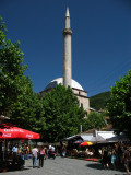 Minaret of Sinan Pasha Mosque and nearby cafes