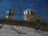Barbed wire and cathedral domes