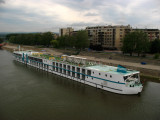 Boat on the Danube and nearby housing blocks