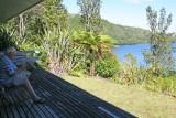 Bill reading the paper at Lake House on Lake Rotoiti