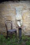 Statue and chair ~