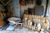 Wheelbarrow & mud bricks