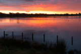 Sunset on floodwaters