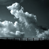 Fence Lines Under Clouds