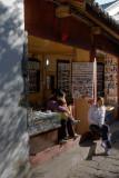 Shop Keeper At Li Jiang Ancient City