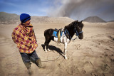 A Tengger and his horse inside the caldera.