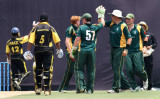 Guernsey players celebrating Madhavan's dismissal