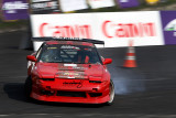 Rhenadi Arinton (Rowdy) from Indonesia driving a red Nissan Silvia 180SX for team Driftbash