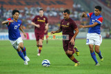 Carlos Tevez weaves past M. Shakir Shaari (17) and Azamuddin Mohd Akil (13)