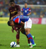 Mohd Safee (blue) tussling with Abdul Razak (maroon)