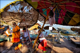 Life under the parasols of Varanasi
