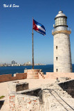 lighthouse and flag at El Morro Fort