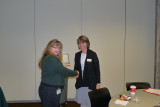 MJ receives certificate of service with a smile
