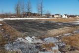 Asphalted area near baseball diamond