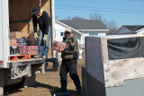 Loading a sleigh in Moosonee with soft drinks for Moose Factory 2011 April 15