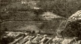 closeup of aerial showing undeveloped land where theaters and strip mall will eventually be