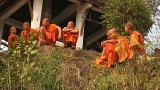 Monks looking on