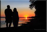 A Couple Enjoy An Evening's Sunset