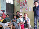 Alexander, me & NorQuest student with some of the children