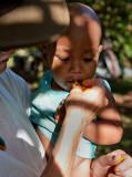 A baby at Sei's farm enjoying egg fruit. March 2011. IMG_3307.jpg