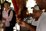 Examining the ivory nut turtle carving. IMG_6353.jpg