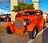 An orange Ford