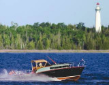Classic Chris Craft Black Beauty rounds Presque Isle