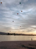 Balloons in the air at sunset