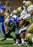 Tech defenders gang tackle Kansas RB Sims
