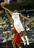 Yellow Jackets G Jason Morris reels in a rebound under the basket