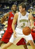 Yellow Jackets C Daniel Miller dribbles under the basket