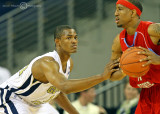 Georgia Tech G Morris checks a Delaware State player as he looks to pass