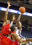 Jackets G Brandon Reed drives the lane and finds defensive resistance