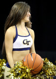 Georgia Tech Yellow Jackets Cheerleader gets a rebound