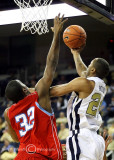 Jackets F Hosley fights off Hornets F Marques Oliver to put up a reverse layup