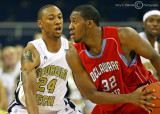 Yellow Jackets F Hosley puts defensive pressure on Hornets F Oliver