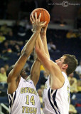 Georgia Tech G Morris and C Miller both work to secure a rebound