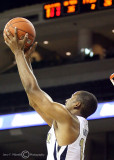 Georgia Tech G Morris catches a pass near the front of the rim