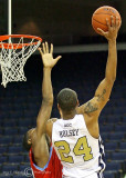 Yellow Jackets F Hosley puts up a short hook shot over a Hornets defender